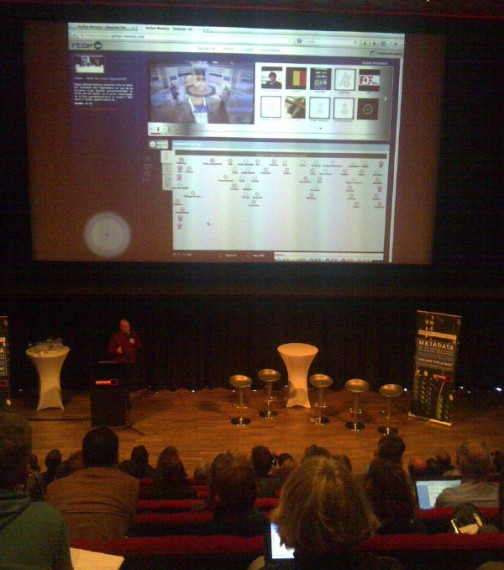 Xavier Jacques-Jourion of RTBF demonstrating the GEMS semantic-based multimedia browser prototype, with video top-left and automatically-generated metadata linked to open data sources below