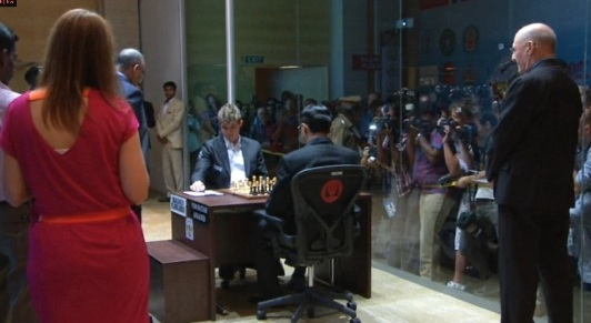 Carlsen and Anand (with his back to the camera) before the start of their first game on 9 November 2013