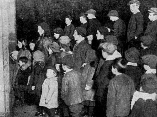 Children queuing in a cinema foyer c.1910