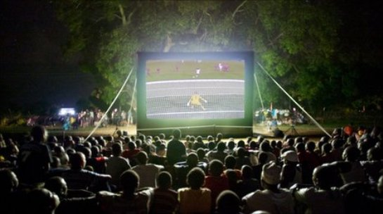 Watching football on an inflatable screen in Kenya, via BBC