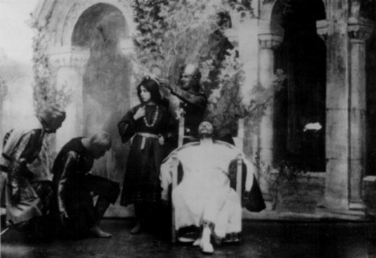 Herbert Beerbohm Tree (dressed in white) in King John (1899). Image via EYE Film Institute