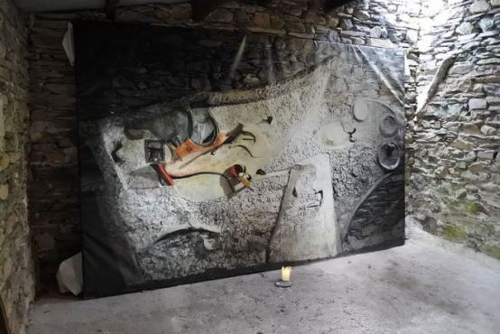 Actual size photographic recreation of the removed artwork, inside the Merz Barn