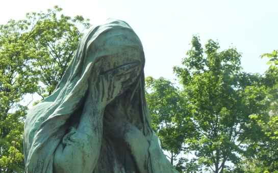 Weeping angel at Père Lachaise Cemetery, Paris