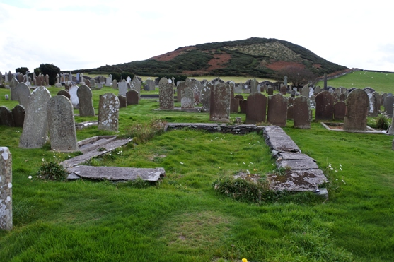 Remains of a keeill in Maughold churchyard