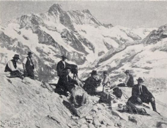 Members of the Urban Alpine Expedition on the Jungfrau, with filmmaker Frank Ormiston-Smith standing by the camera