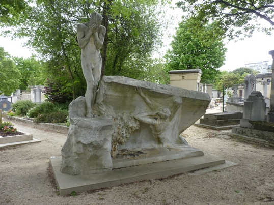 Weeping for the dead - a sculpture at Montparnasse cemetery