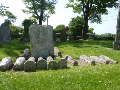 The thirteen children's gravestones at St James' church, Cooling, inspiration for the opening scene of Great Expectations