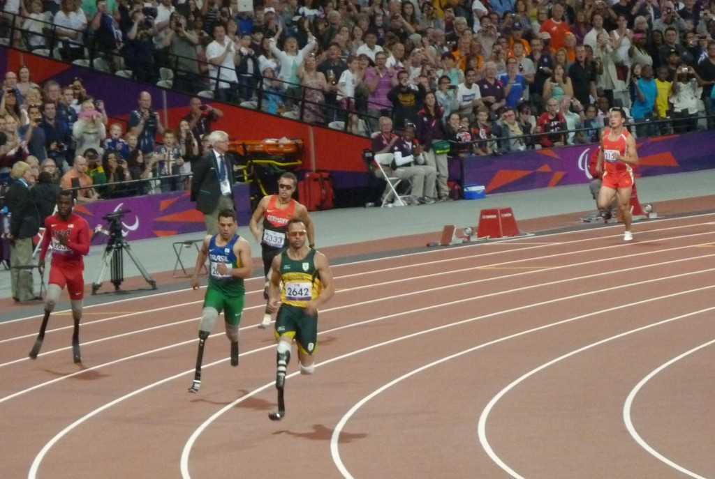 Oscar Pistorius on his way to winning the Men's 400m T44, with Alan Oliveira to his right